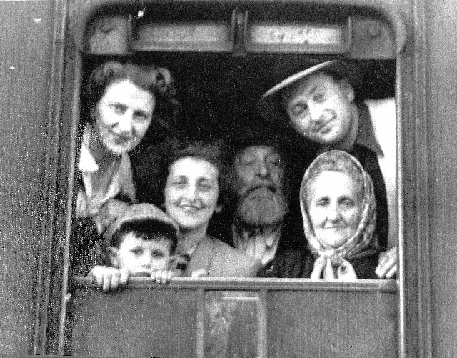 Israel Lieb Bochner family 1946 or 1948 returning via train from USSR to Salzburg, Austria.  They later moved to NYC, USA.  L to R: Top left is Chunek's wife, below is Naftali Bochner (Chunek's son), Sabina Bochner (Chunek's sister), Israel Lieb Bochner, Israel Lieb's wife, and top right is Chunek Bochner (Israel Lieb's son)