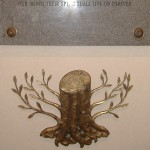 A truncated tree relief sculpture is hung below a Holocaust memorial plaque at the back of the sanctuary at Congregation Shaarey Tikvah in Beachwood, Ohio.  The sculpture was designed by Holocaust survivor Jacob Hennenberg.  It was manufactured in the 1950s in Cleveland at the Alcraft Manufacturing Company, a metalworking company owned by another Holocaust survivor, Alfred Chimowicz.  The tree cut off at the trunk represents the lives cut short by the Holocaust.