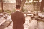Oswiecim Jewish Cemetery in July 1979.  Jacob stands saying Kadish.